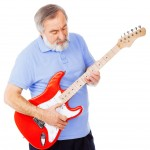 Old guy playing a red guitar